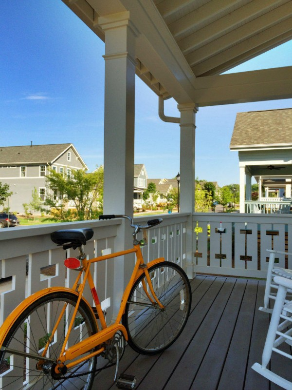 118243244476616_bike_on_porch_riverwalk_vertical_850